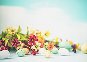 Easter arrangement with bright flowers and Easter eggs