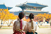 Korean lady in hanbok dress walk and travel