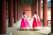 Korean lady in hanbok dress walk and travel in palace in Seoul city