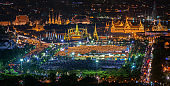 Wat Phra Keaw and Thai people with a candle on hand in Bangkok