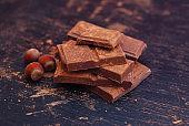 Broken Chocolate Pieces and Cocoa Powder on Black background. Dessert Recipie Ingredinets. Food Preparation