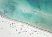 Pastel colored, aerial view of a beach