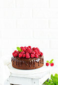 Delicious chocolate cake with chocolate icing and raspberries.
