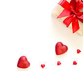 A gift on a white background with decorations. The concept of the St. Valentine's day, weddings, birthday and other holidays.