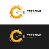 Creative symbol with letter C and light bulb.