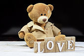 Bear on a wooden background with a love sign