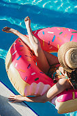 Young adult woman resting on inflatable during vacation