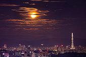 Seoul City SkyLine at night and full moon in Seoul South Korea.