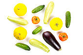 Vegetarian healthy food with vegetables. Tomato, cucumbers, bush pumpkin, eggplant and marrow isolated on white background.