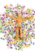 Wooden mannequin lying on Euro notes - jackpot, winner, heritage