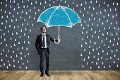 Businessman with creative drawn umbrella