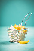 French fries on blue background