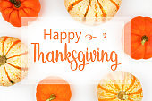 Happy Thanksgiving greeting card with frame of pumpkins over white