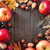 Autumn square frame of apples and fall ingredients over wood