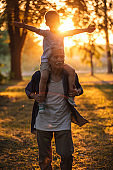 Grandfather carrying grandchild on shoulders