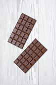 Top view on tasty chocolate bars as snack or ingredient for confectionery