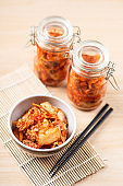 Kimchi cabbage in a bowl and jar