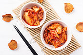 Kimchi cabbage in a bowl with chopsticks