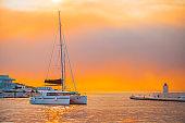 Fancy yacht getting ready to be moored in the harbor of Postira - Croatia, island Brac