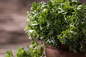 tied fresh parsley on wooden surface, healthy food