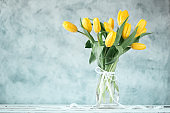 beautiful yellow tulips on wooden background, father, mother, women, valentine's day concept