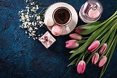 romantic breakfast Cappuccino ,strawberry macaroons, pink tulips,