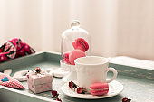 romantic breakfast in bed. Cappuccino ,strawberry macaroons
