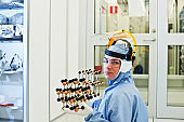 Research Student Poses With A Molecular Structure: Model in The Lab
