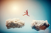 Man jumping from one cloud to another. Challenge.