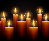 Seamless border with luminous candles on a dark background.