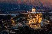 Old Orhei stone carved church at sunset Moldova Republic