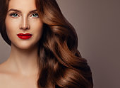 Beautiful Redhead Woman Fashion Model with Perfect Wavy Hairstyle and Makeup, Pretty Female Face Closeup