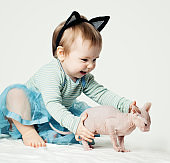 Cute baby girl and kitten. Child with pet