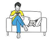 Man using smartphone on sofa