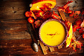 Pumpkin soup on a wooden table