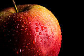 Wet red apple. Macro drops on apple