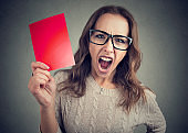 Screaming woman with red card