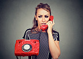 Worried woman receiving bad news on a phone