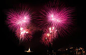 Colorful fireworks explosion with aerial view of buddha temple on the mountain background
