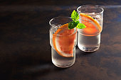 Refreshing cold water in a glass with slices of grapefruit and mint.Copy space.Summer drink detox