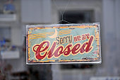 Hanging closed sign in the glass