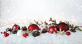 Christmas holiday elegant baubles with falling snow and glittery lights