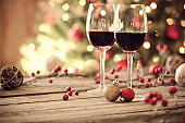 Christmas holiday red wine in front of a Christmas tree