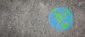 Closeup earth draw with chalk on the street wall. Background of world harmony green peace environment