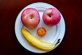 smiling face made of fruit:banana and apple