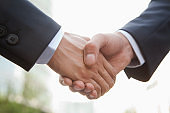Businessman handshaking after partnership meeting