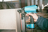 Factory Worker Stitching Furniture For Bed Construction