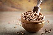 Raw organic chickpeas in a wooden bowl, healthy vegan vegetarian food ingredient.