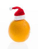 Orange wearing Santa hat on white background