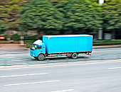 Blue freight truck driving on the road